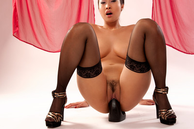 Pics of busty asian babe Sharon Lee playing with a big dildo