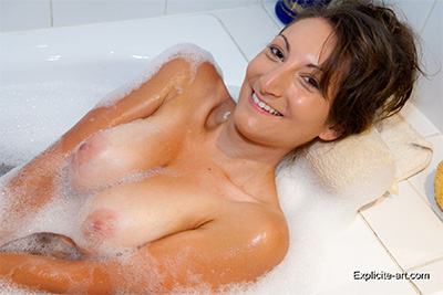 Pics of Busty Charlotte de Castille teasing you in the bath.