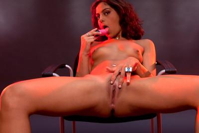 Strip tease and masturbation pics of a French debutante in studio