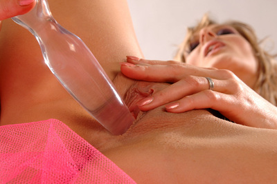 Busty blond pornstar Jane Darling maturbating with a crystal dildo in video
