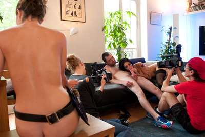 The making of a porn video with a couple and a naked make-up artist
