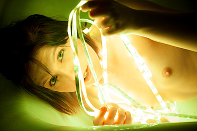 Photos of lovely Perle carter posing nude in thelight of a LED garland