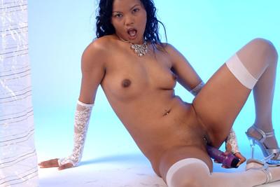 Photos of asian French babe Geisha masturbating with a dildo in studio