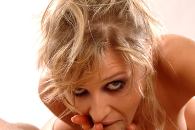 POV photos of blond porn star Jane Darling doing a blowjob