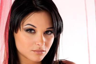 Photos of busty beautiful French pornstar Jessyca Wilson striptease