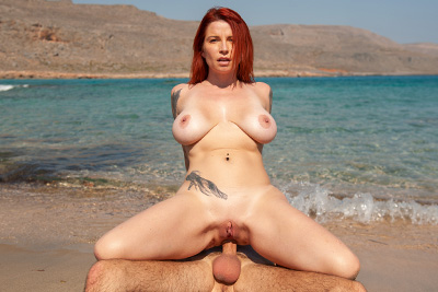 Photos of French busty MILF Julie Valmont sodomy on the beach