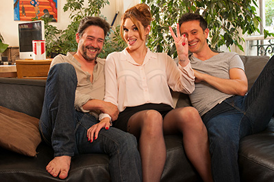Busty French redhead babe fucking with two guys on the couch 1/2