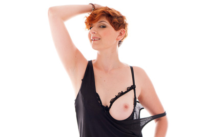 Redhead busty debutante in her first strip-tease video