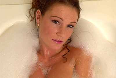 A cute French debutante plays with a dildo in her bath in video