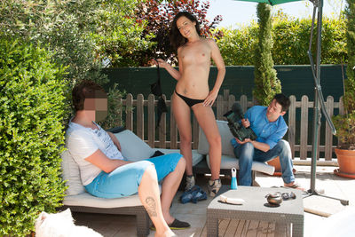 Young French brunette in a hardcore casting. Threesome by the pool